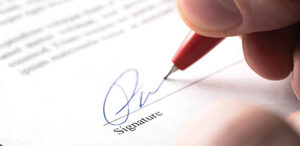 Image signing official document, selling or retiring from business